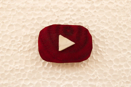 Tyumen, Russia - September 02nd, 2017: Youtube logo made from pieces of beetroot and cabbage on the white background from foam plastic, top view.