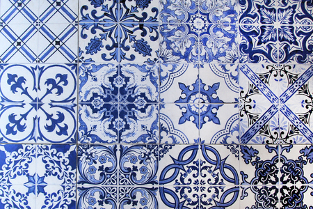 A wall from colorful ceramic tiles for background.