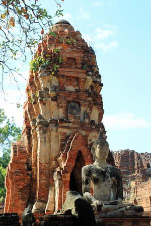 The ruins of ancient city with statue of Buddha. Ayutthaya Historical park. Ayutthaya, Thailand.