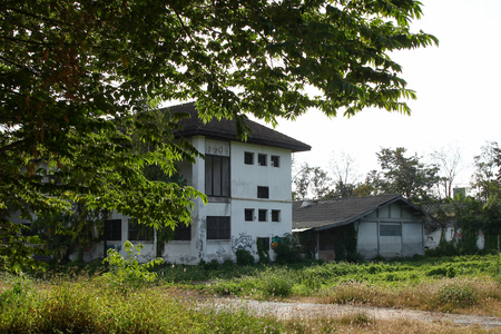 Chiang Mai, Thailand - December 25, 2017: View on the administrative buildings and prison blocks in abandoned women prison.