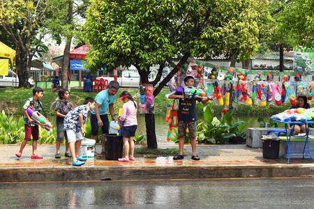 Chiang Mai, Thailand - April 12, 2018: Celebrating Songkran (Thai New Year) by Thai people on a street. Water Festival - one of the most popular holidays in Thailand.