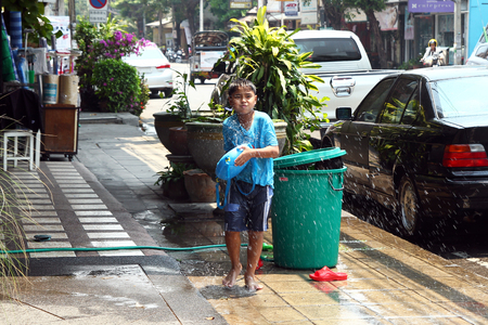 Chiang Mai, Thailand - April 12, 2018: Young Thai boy with water gun on Songkran festival (Thai New Year).