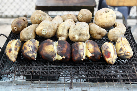 Traditional street food of Thailand - grilled bananas and sweet potato. Chiang Mai, Thailand. Stock Photo