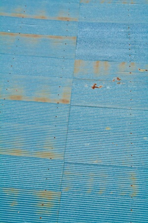 A rusty corrugated iron metal fence close up Zinc wall  photo