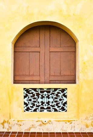 European window with wrought iron in Bangkok, Thailand.  photo