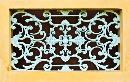 European window with wrought iron in Bangkok, Thailand.  photo