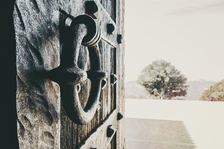 Close-up of a forging knob of an old wooden door with perspective Stok Fotoğraf