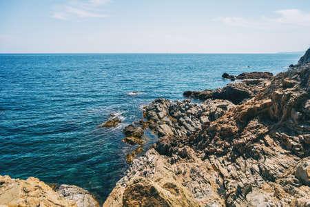 Seascape of a steep rocky coast on a sunny day