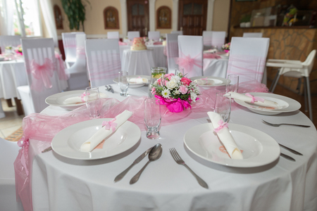 restaurant tables: A very nicely decorated wedding table with plates and Serviettes. A table set for wedding. Stock Photo