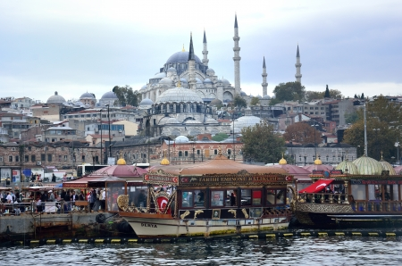 anatolia: A view from Galata Bridge Traditional fish restaurant by the sea and the Suleymaniye Mosque in the background, Istanbul