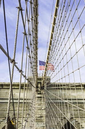 boroughs: The Brooklyn Bridge is a bridge in New York City and is one of the oldest suspension bridges in the United States. Completed in 1883, it connects the boroughs of Manhattan and Brooklyn by spanning the East River. With a main span of 1,595.5 feet (486.3 m)