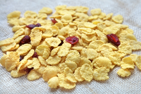 corn-flakes with cranberries on linen tablecloth Stock Photo - 18136440