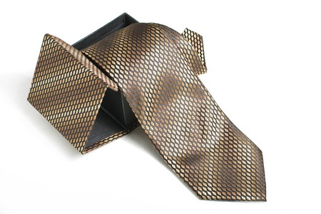 Brown tie in box on white background Stock Photo - 6978985