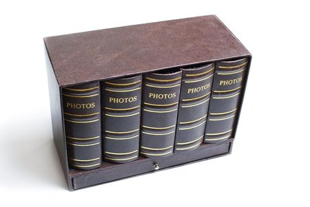 Five photo books in mini bookcase isolated on white background photo