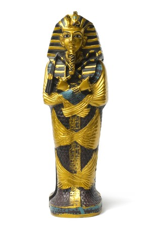 ancient egyptian culture: Toy golden and small pharaoh statue stays on white background