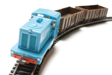 Blue toy locomotive and brown wagons isolated on white background photo