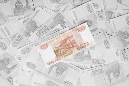 allocated: Pack of the highest valued and printed russian money. The most valuable is allocated by color