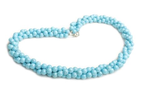 Blue lazurite necklace made from balls isolated on white background