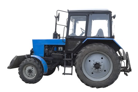 Blue medium agricultural tractor after the several years of usage. Isolated on white background photo