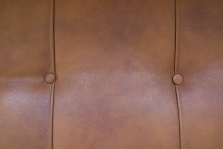 Brown soft leather sofa texture with stitches photo