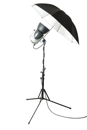 Single set of professional flashlight and umbrella. Isolated on white background photo