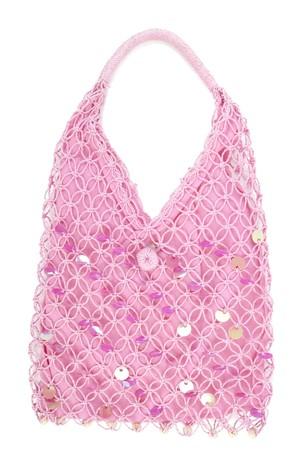 Pink textile handbag. Isolated on white background photo