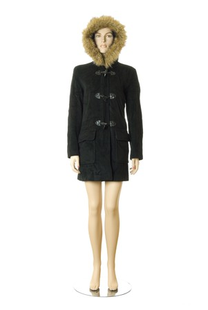 Female mannequin in black short winter coat with furry hood. Isolated on white background photo
