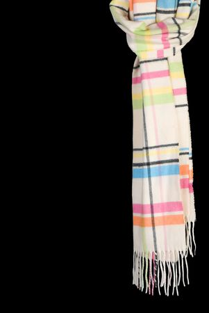 Multicolored winter scarf. Isolated on black background