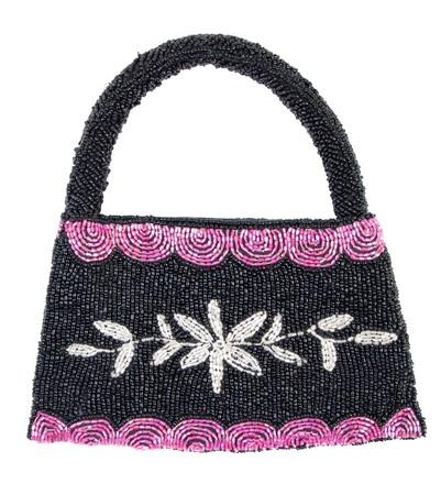 Black female handbag decorated with beads. Isolated on white background photo