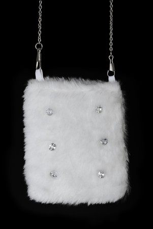 pastes: White fur pouch with pastes. Isolated on black background Stock Photo