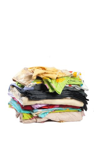 bedclothes: Colorful stack of dirty bed-clothes is ready for laundry. Isolated on white background