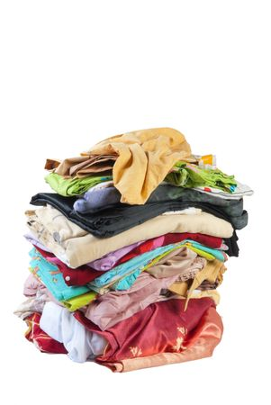 Colorful stack of dirty bed-clothes is ready for laundry. Isolated on white background