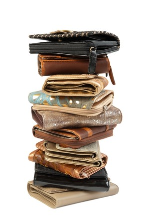 10 leather purses in stack. Isolated on white background