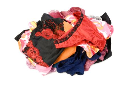 Colorfull pile of female panties. Isolated on white background