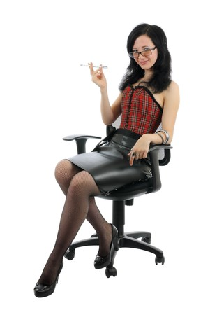 Young adult with pen in hand is smiling in office chair. Isolated on white photo