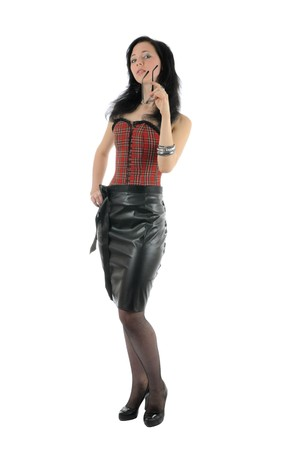 leather skirt: She removes glasses with slightly opened mouth. Girl wears corset, leather skirt, stockings and bracelets. Isolated on white