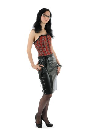 leather skirt: Woman in glasses, corset and leather skirt is posing with blank face expression. Isolated on white