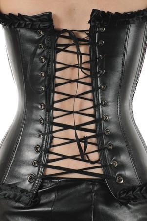 corsetto: Retro della donna nel corsetto di cuoio nero. Isolato su sfondo bianco Archivio Fotografico