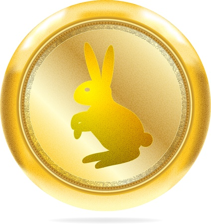 Golden round icon with the rabbit symbol of 2011 year. photo