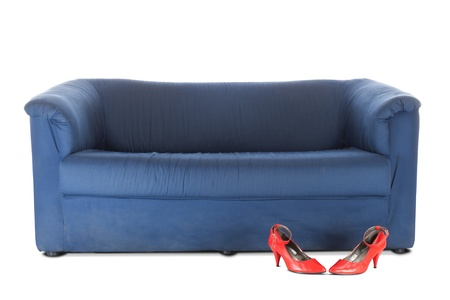 Blue textile couch and red female shoes. Conceptual photo. Isolated over white Stock Photo - 8464661