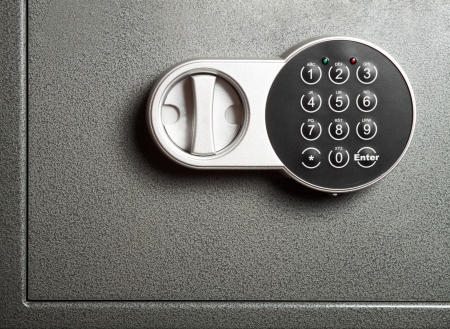 combination: Close-up to steel safe door with electronic combinational lock