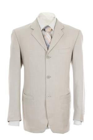 Empty light office jacket for manager. Also light shirt and necktie. Isolated over white Standard-Bild