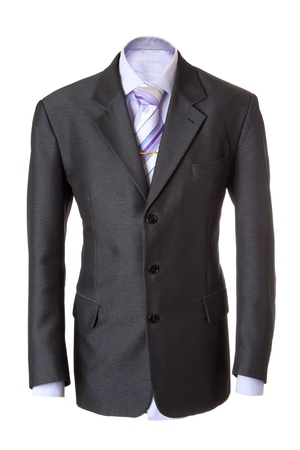 Empty grey office suit. Also lilac shirt, necktie and golden clip. Isolated over white