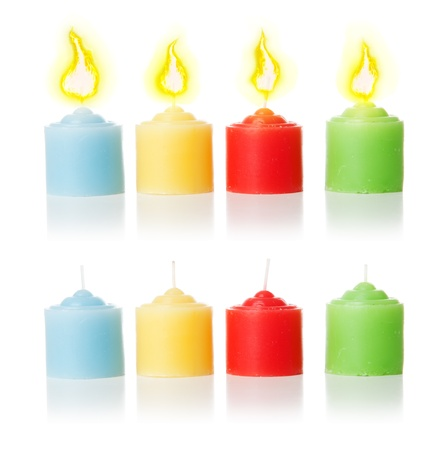 4 colorful candles with candlelight and without it. Isolated over white background photo
