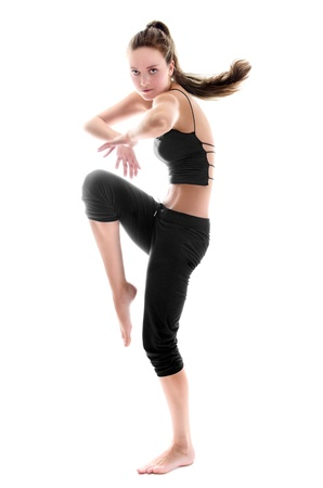 Young beauty woman is dancing. Isolated over white background Stock Photo - 10943411