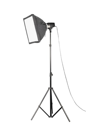 Small softbox 45cm X 45cm and portable studio flash isolated over white background Stock Photo