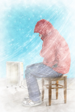 Cold winter wind with snow blows in the living room. Freezing guy in warm clothes is sitting near the heating radiator. Stock Photo