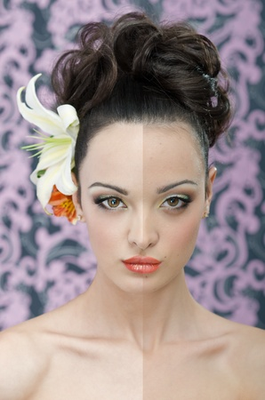 Close up beauty head shot of young adult woman with make-up, hair style and lily flowers in hair photo