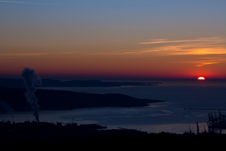 the sun goes down in the bay of Trieste photo