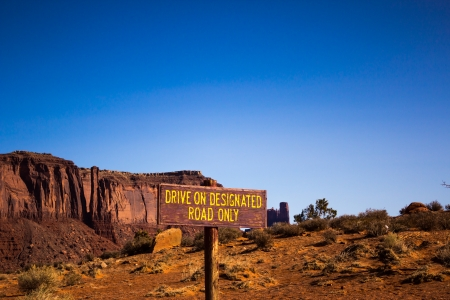 a sign on the middle of Monument Valley National Park photo